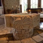 Baptismal Font in front of altar.
